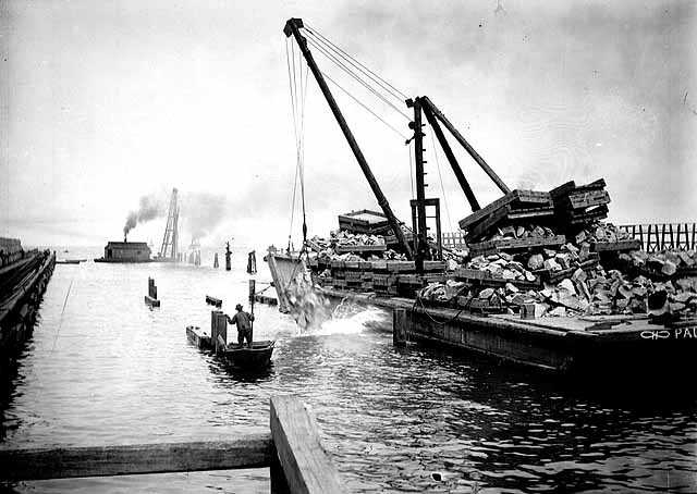 Rocks dropped from loaded barges, Duluth ship canal