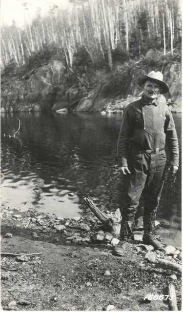 Black and white photograph of Count Rovigno at the foot of the White Iron Portage, Superior National Forest, 1922.