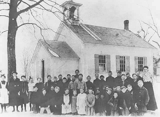 Rural one-room schoolhouse, students, and teacher, ca. 1910. Photograph by John Runk.