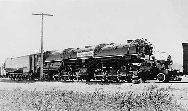 """Black and white photograph of a 221 """"Yellowstone"""" steam locomotive, 1940."""
