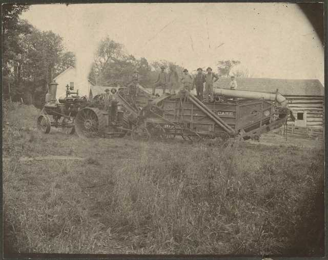 Photograph of farmers and threshing machine, ca. 1900