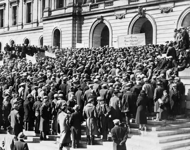 Black and white photograph of farmers storming the Minnesota State Capitol to demand relief, 1933.