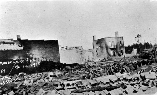 Black and white photograph of street view after fire, Moose Lake, 1918.
