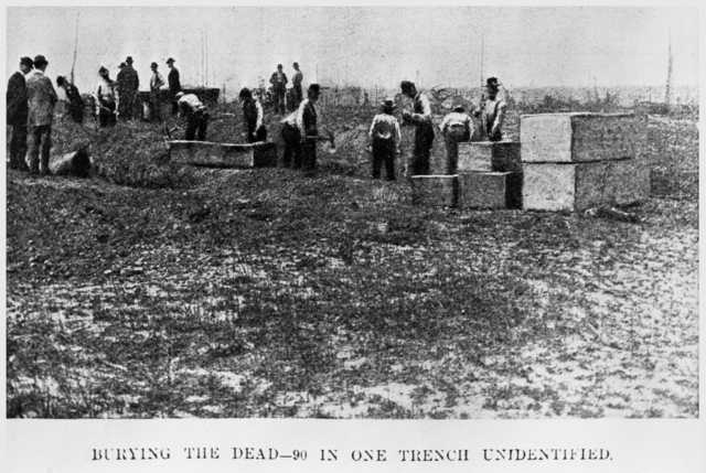 Burying ninety victims in one trench following the Hinckley fire, September, 1894.