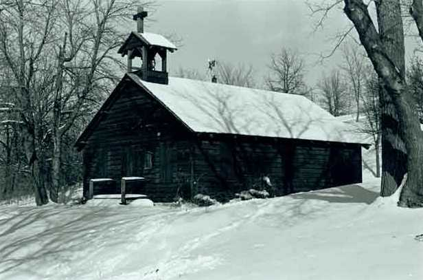 Black and white photograph of the restored Dakota mission of Stephen R. Riggs and Thomas S. Williamson at Lac qui Parle State Park, 1971. Photographed by Jack Renshaw.