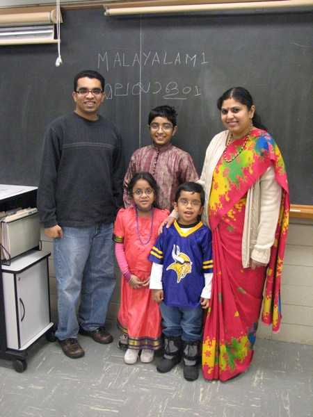 Color image of students in a Malayalam class (level 1) pose for a photograph at the School of India for Languages and Culture (SILC) on Social Studies Day, ca. 2015, in St. Paul.