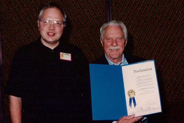 Color photograph of MN Cartooning Historian David Mruz with Curt Swan, October 2, 1993.