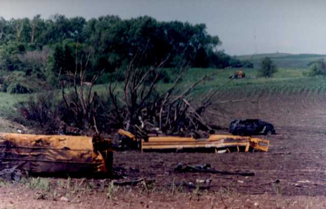 The remains of two school buses in a field after Chandler–Lake Wilson Tornado, June 1992.