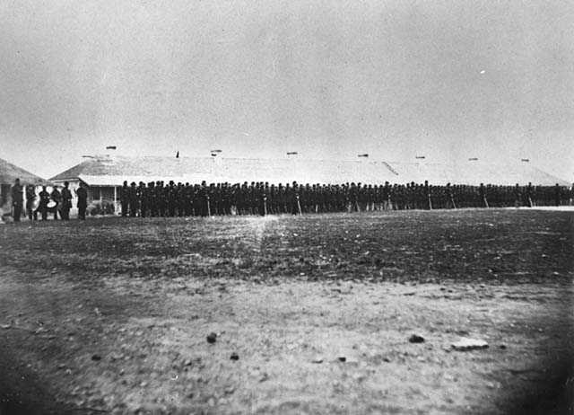 Second Minnesota Volunteer Infantry standing in front of the Long Barracks
