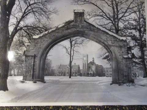 Black and white photograph of Shattuck School, Faribault, c.1949. The arch and Shumway, designed in 1886, and Morgan Refectory designed in 1888.