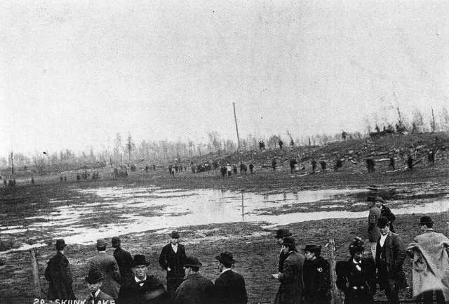 People gather at Skunk Lake after the Hinckley Fire, which occurred on September 1, 1894. Photograph Collection, Hinckley Fire Museum, Hinckley.