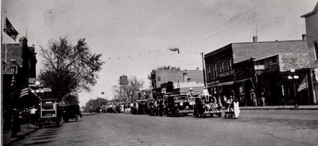 Black and white photograph of a parade in Slayton, 1930.