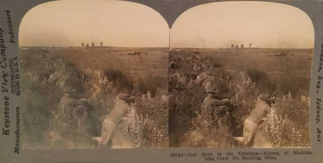 Black and white stereoview of officers-in-training in a trench during a drill at Fort Snelling, ca. 1917.