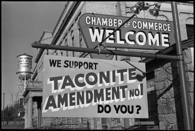 """A sign outside a business promoting a """"yes"""" vote on the taconite amendment, 1964."""