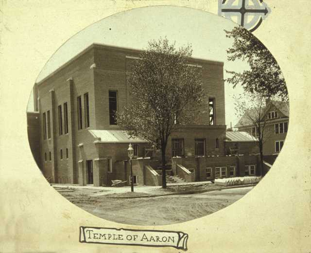 Black-and-white matted photograph of the exterior of Temple of Aaron in 1916.