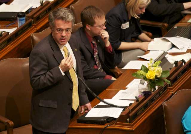 Color image of Minnesota Representative Terry Morrow (DFL) speaking on the House floor against SF 1308, 2011.