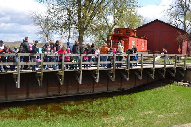 Color image of a tour group at End-O-Line Railroad Park in Currie, May 2014.