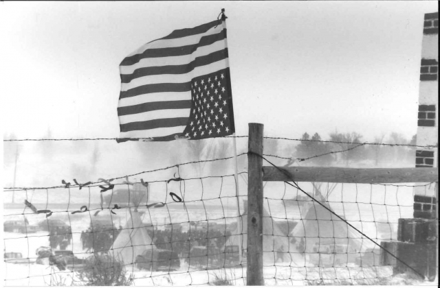 Upside-down American flag flying at Wounded Knee