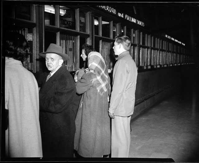 Passengers purchase train tickets at the St. Paul Union Depot.