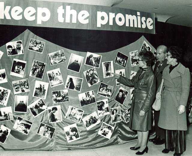 Black and white photograph of a photo collage display made by the United Jewish Federation Council, undated.