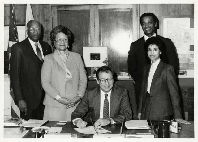 Photo related to United Negro College Fund. Pictured are (left to right) Oscar and Virginia Howard, Minneapolis Mayor Donald Fraser, and Claudeth and Gene Washington, December 1984. Oscar C. Howard papers, 1945–1990 (P1842), personal papers (1945–1990), Manuscripts Collection, Minnesota Historical Society.