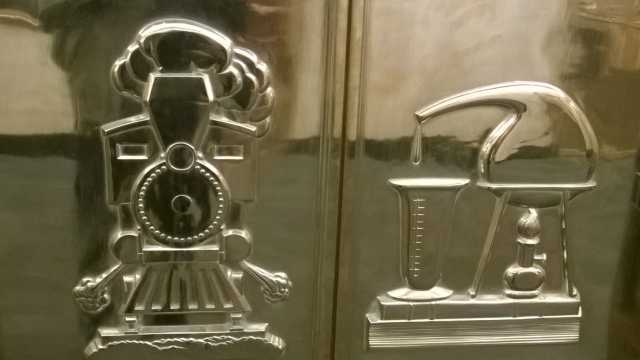 Close-up view of relief sculptures by John Stewart on elevator doors inside the St. Paul City Hall and Ramsey County Courthouse. Photographed by Paul Nelson on April 24, 2014.