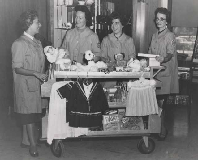 Black and white photograph of workers from the Mount Sinai Hospital Auxiliary, the hospital's fundraising, service and public relations organization, 1955.