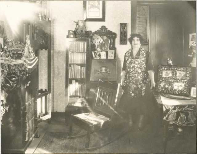 Black and white photograph of Susie Hanson Smith With Button Collection.