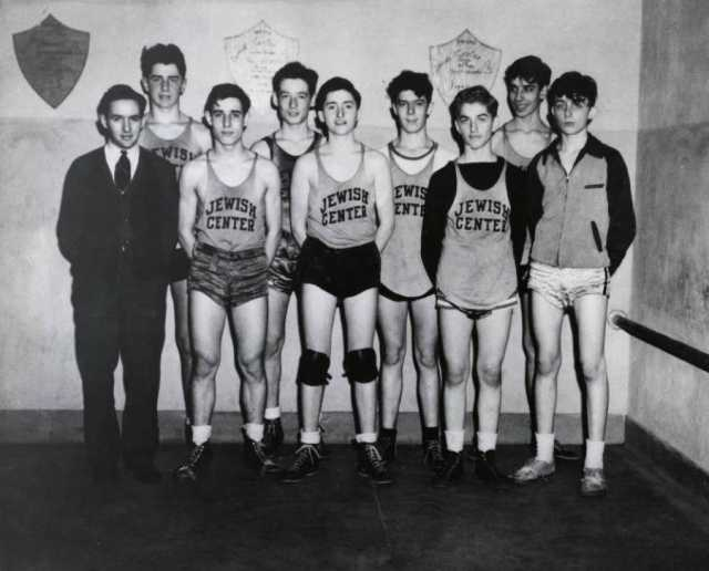 Black and white photograph of a young men's basketball team at the Jewish Educational Center in Saint Paul, c.1940.