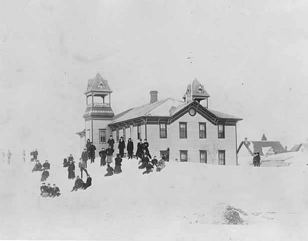 photograph of Dawson school with children playing in the snow.