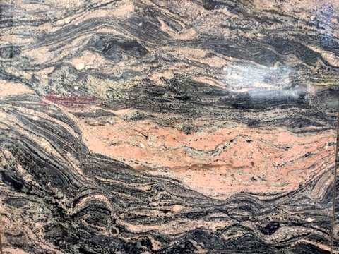 Color image of Morton gneiss used on the façade of the West Publishing Company building in St. Paul, 2016. Photograph by Paul Nelson.