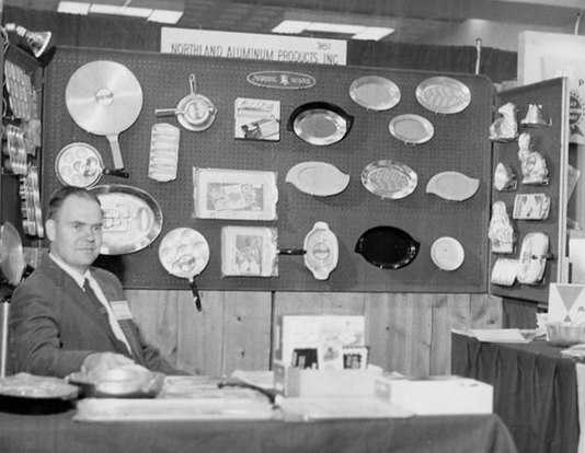 Black and white photograph of H. David Dalquist, ca. 1955, at a first Chicago Housewares Show—the first in which Nordic Ware participated.