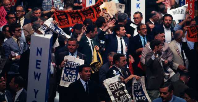 Color image of anti-war delegates oppose Humphrey's nomination at the 1968 Democratic Convention in Chicago.