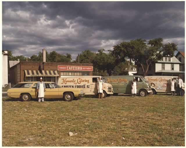 Howard's Cafeteria with four catering delivery vehicles, 3300 Fourth Ave South, Minneapolis, ca. 1970s. Photo by H.M. Schwang Photo Co. Oscar C. Howard papers, 1945–1990 (P1842), Cafeteria and Industrial Catering Business, Manuscripts Collection, Minnesota Historical Society.