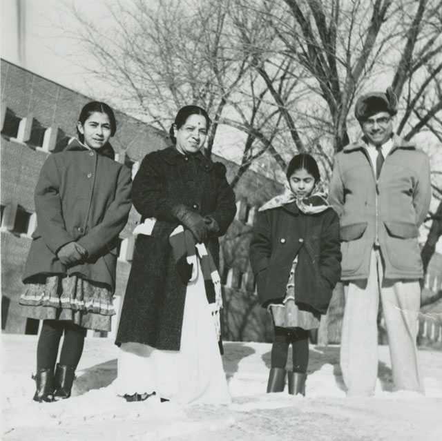 Black and white photograph of Dr. Padmakar K. Dixit, his wife, and their two daughters in Minnesota, 1962.