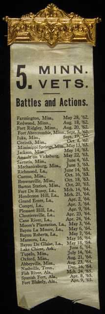 White ribbon with a list of the locations and dates of major battles of the 5th Minnesota Volunteer Infantry.