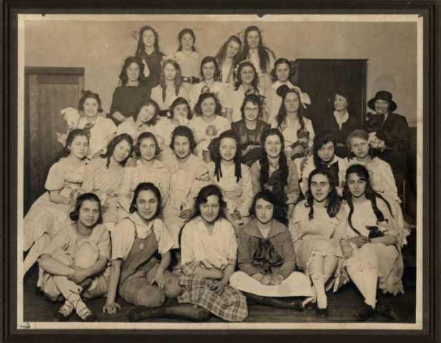 Black and white photograph of Girls' Club doll party at West Side Neighborhood House, St. Paul, 1919.