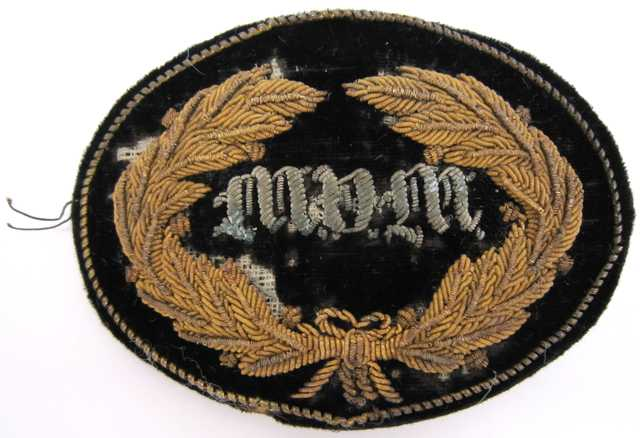 """United States Army General and Staff officers hat insignia worn during the Civil War by General John B. Sanborn of the 4th Minnesota Regiment. The velvet patch is embroidered in bullion with a wreath and the letters """"MVM"""" (Minnesota Volunteer Militia)."""