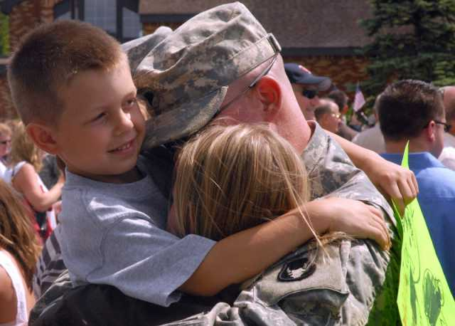 Color image of a soldier of Second Battalion, 135th Infantry, Thirty-fourth Division, returning home after a deployment, 2008.