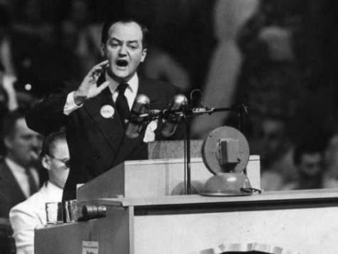 Black and white photograph of Hubert Humphrey delivering a speech on civil rights at the 1948 Democratic National Convention in Philadelphia.