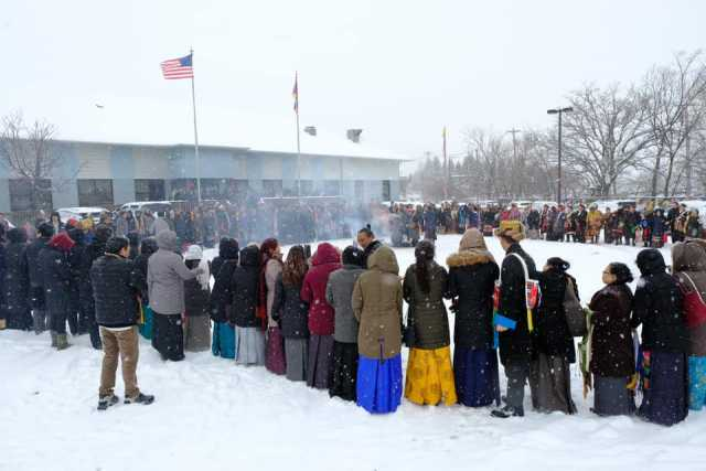 Tibetan Minnesotans perform an incense-burning ceremony for the wellbeing and health of their spiritual leader, His Holiness the Dalai Lama at the Tibetan American Foundation of Minnesota in St. Paul, ca. 2018. Photograph by Tashi Khongtsotsang.