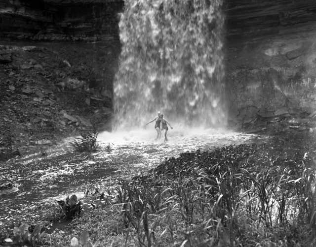 Two women in bathing suits under Minnehaha Falls