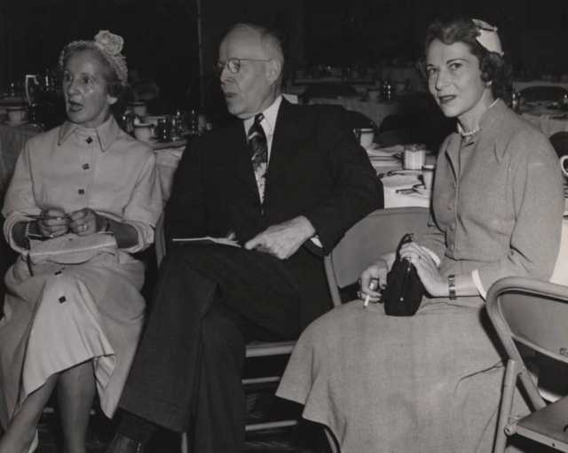 Black and white photograph of Ruth Melamond, Dr. Owen Wangensteen, and Luella Maslon at a Mount Sinai Women's Auxiliary function, 1952.