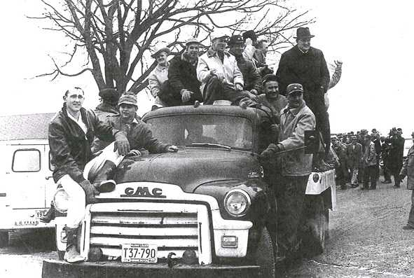 Black and white photograph of NFO farmers and creamery employees ride a bulk truck out to milk dumping site on the Martin Lampi farm near Annandale on March 7, 1963.