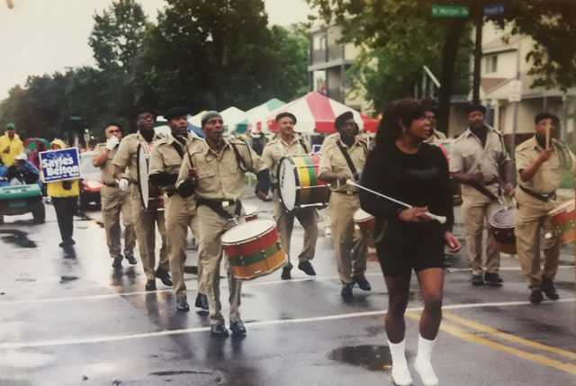 Color image of the Sabathanites Drum Corps marching in parade in Minneapolis, ca. early 2000s. Photographed by Suluki Fardan.