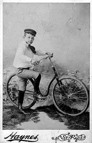 Boy and his bicycle