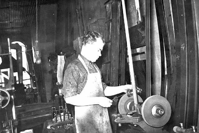 John E. Strauss, Jr. sharpening a skate blade