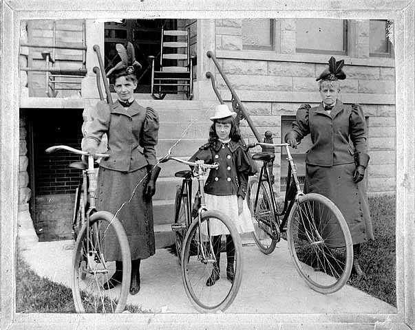 Two women and girl with bicycles