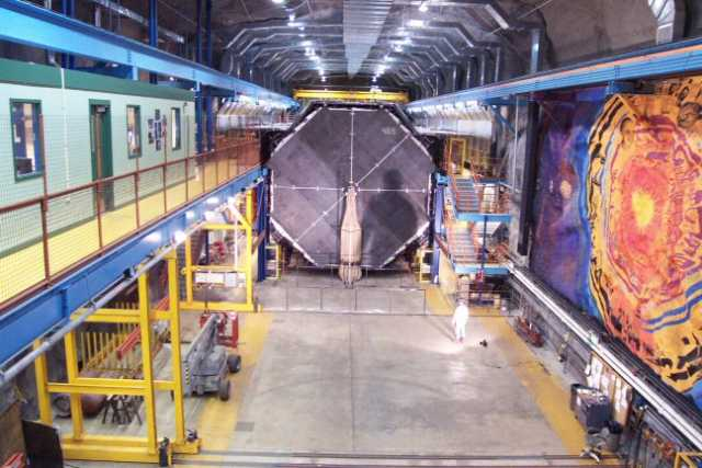 Color image of the front face of the MINOS far detector. On the left is the control room; on the right is a mural by Joseph Giannetti.