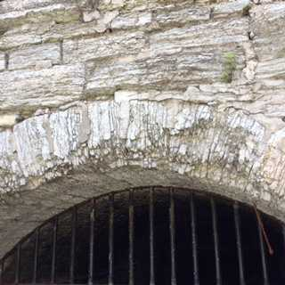 Color image of a Platteville limestone arch, Mill Ruins Park, Minneapolis, 2016. Photograph by Paul Nelson.